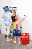 Small children washing a wall Royalty Free Stock Image