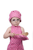 Small children, with a wooden spoon and cook costume Royalty Free Stock Photography