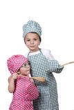 Small children, with a wooden spoon and cook costume Stock Photography