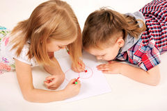 Small childrenl drawing heart. Love concept. Stock Images