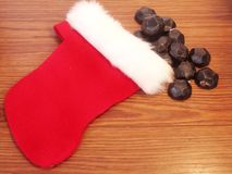 Small childs christmas stocking with coal Royalty Free Stock Image