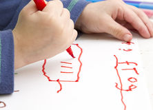 Small childs hands drawing Royalty Free Stock Photos