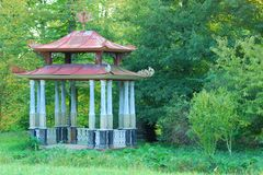 Small Chinese Arbour. In a green forest park Stock Photos