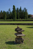 Small Chinese decorative pagodas in the garden. Small Chinese decorative stone pagodas on the grass in the layered garden Royalty Free Stock Image