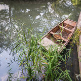 Small Chinese wooden boat Stock Images
