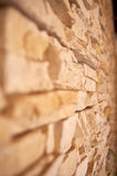 Small chipped stones wall. Closeup of a wall made by chipped stones Royalty Free Stock Photos