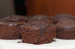 Small chocolate cakes with dripping chocolate icing on top Stock Photo