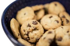 Small chocolate chip breakfast cookies in cereal bowl close up royalty free stock photography