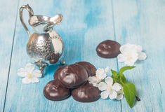 Small chocolate-covered cream cakes Stock Photography
