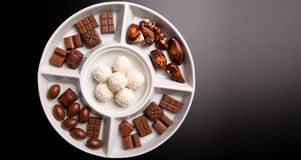 Small chocolate flavours on white plate Royalty Free Stock Photography