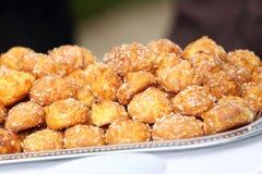 Small chou bun coated with sugar Royalty Free Stock Photo