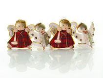 Small Christmas angels. Christmas decoration; cute angels over white Stock Photography