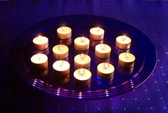Small Christmas candles. On glass tray royalty free stock photos