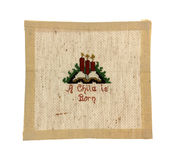 Small Christmas Cross Stitch Embroidery. Very fine cross stitch embroidery on even weave linen Royalty Free Stock Photography