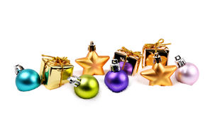 Small Christmas decoration items in snow Royalty Free Stock Images
