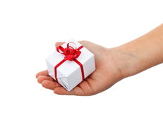 Small christmas gift in child hand Royalty Free Stock Photography