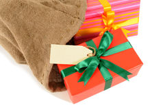 Small Christmas gifts and label inside mail delivery bag, white background Stock Photography