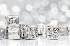 Small Christmas gifts in shiny silver paper Royalty Free Stock Image