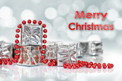 Small Christmas gifts in shiny silver paper Stock Image