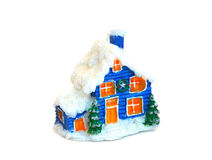 Small christmas house. With a snow roof and red windows Royalty Free Stock Photography