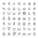 Small Christmas Icons Set on Vector Illustration. Small christmas icons set including, santa claus, forest reindeer, snowflakes and presents, stars and candles Stock Image