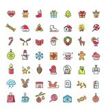 Small Christmas Icons Set on Vector Illustration. Small christmas icons set including, santa claus, reindeer, snowflakes and presents, stars and candles, wreath Stock Photo