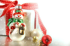 Small christmas ornament with gift. Against white background royalty free stock photo