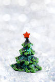Small Christmas toy fir. With grey lights background Stock Image