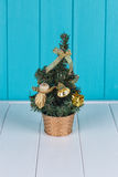 Small Christmas tree. Against the background of the fence Stock Photography