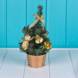 Small Christmas tree. Against the background of the fence Stock Photo
