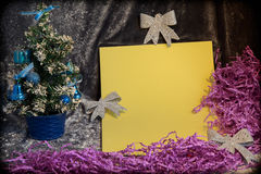 Small  Christmas tree on background for postcards and greetings Stock Photography