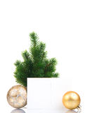 Small christmas tree with balls and postcard Stock Image