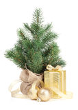 Small christmas tree with decor and gift box Royalty Free Stock Image