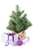 Small christmas tree with decor and gift box Royalty Free Stock Photos