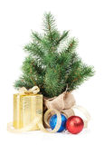 Small christmas tree with decor and gift box Stock Images