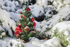 Little Christmas tree with toys in the snow royalty free stock photos