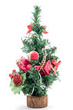 Small christmas tree with gift and ball. Royalty Free Stock Photography