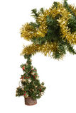 Small christmas tree hanging on branch Royalty Free Stock Photos