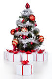 Small Christmas tree with lots of presents Royalty Free Stock Images