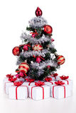 Small christmas tree with lots of presents. In white gift boxes - isolated Royalty Free Stock Image