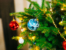 A small Christmas tree in a pot, decorated with balls, garlands Stock Image
