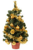 Small christmas tree in pot with yellow balls Royalty Free Stock Photo