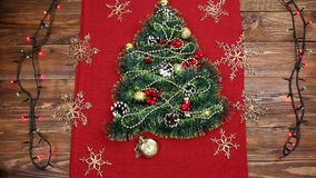 A small Christmas tree of tinsel, nuts, ribbons and ornaments. Gift for a Christmas tree, a vintage watch. 2018,. A small Christmas tree of tinsel, nuts, ribbons stock video