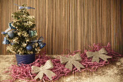 A small Christmas tree on a wooden background for postcards and Stock Image