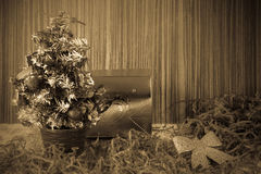 A small Christmas tree on a wooden background for postcards and Stock Photography
