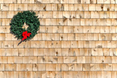 Small Christmas wreath on a cedar shingle wall Royalty Free Stock Image