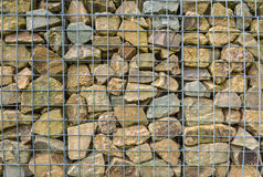 Small chunks of rock behind a mesh fence Stock Photography