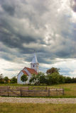 Small church against dramatic sky Stock Images