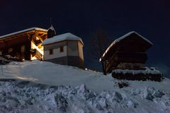 Small church in the alps at night royalty free stock photography