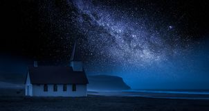 Small church on the beach at night with stars, Iceland. Europe Stock Photography